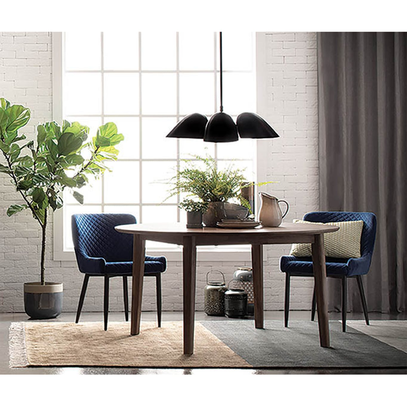 Round wooden dining table with 2 navy dining chairs