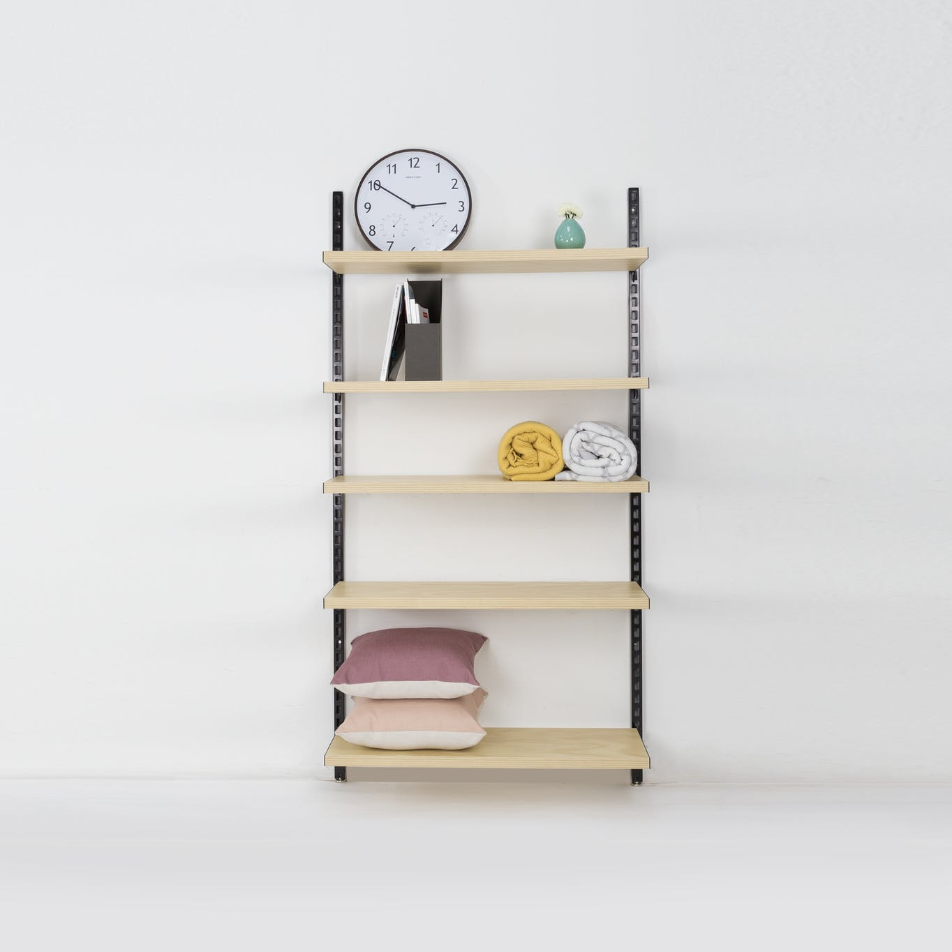 Book shelf storage system with black tracks and wooden shelves