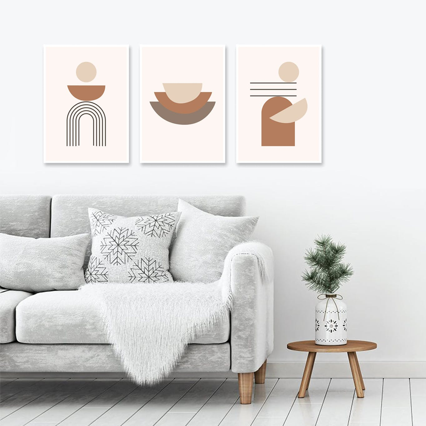 Prints hung up in living room behind sofa