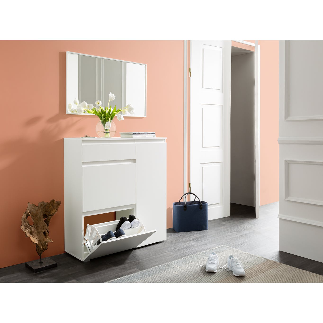white wooden shoe cabinet placed at entryway of home