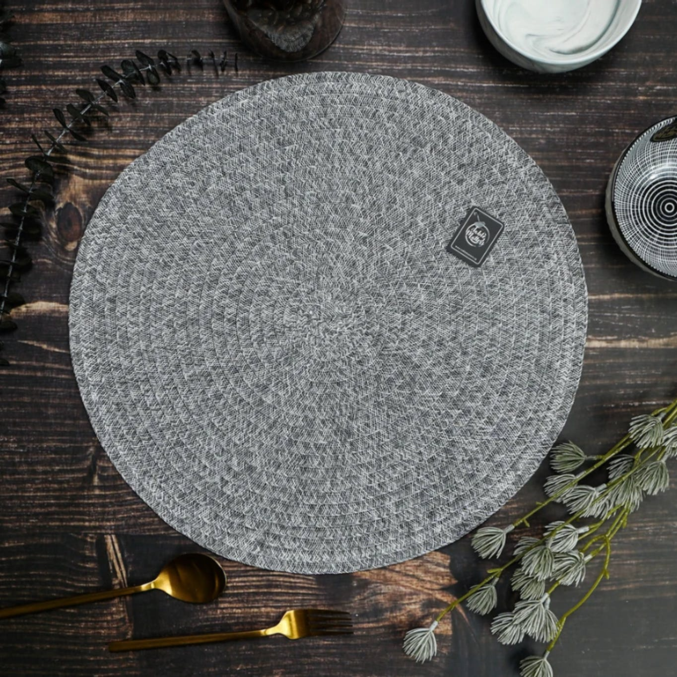 Grey woven round placemat