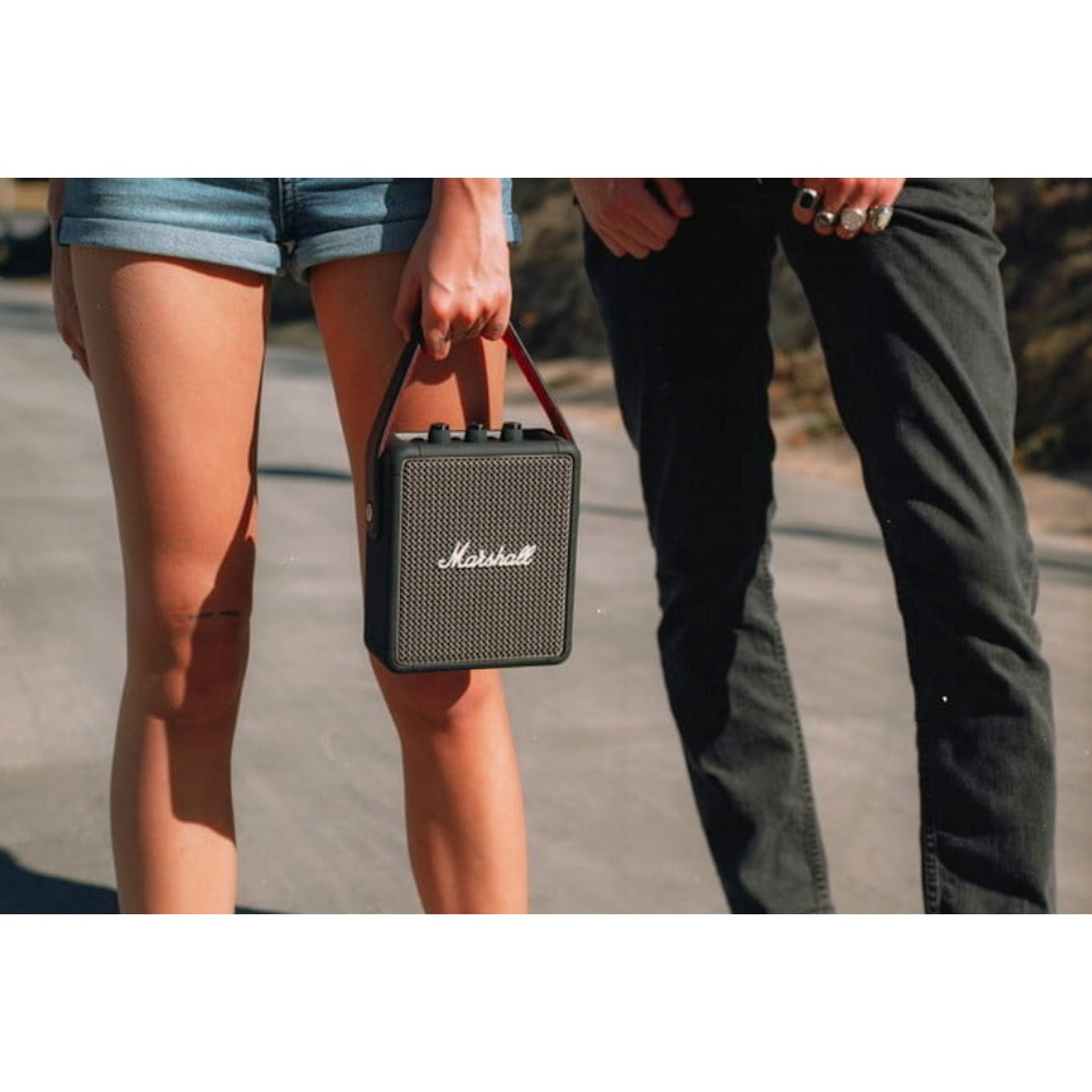 Marshall stockwell II wireless speaker in black being held by a lady