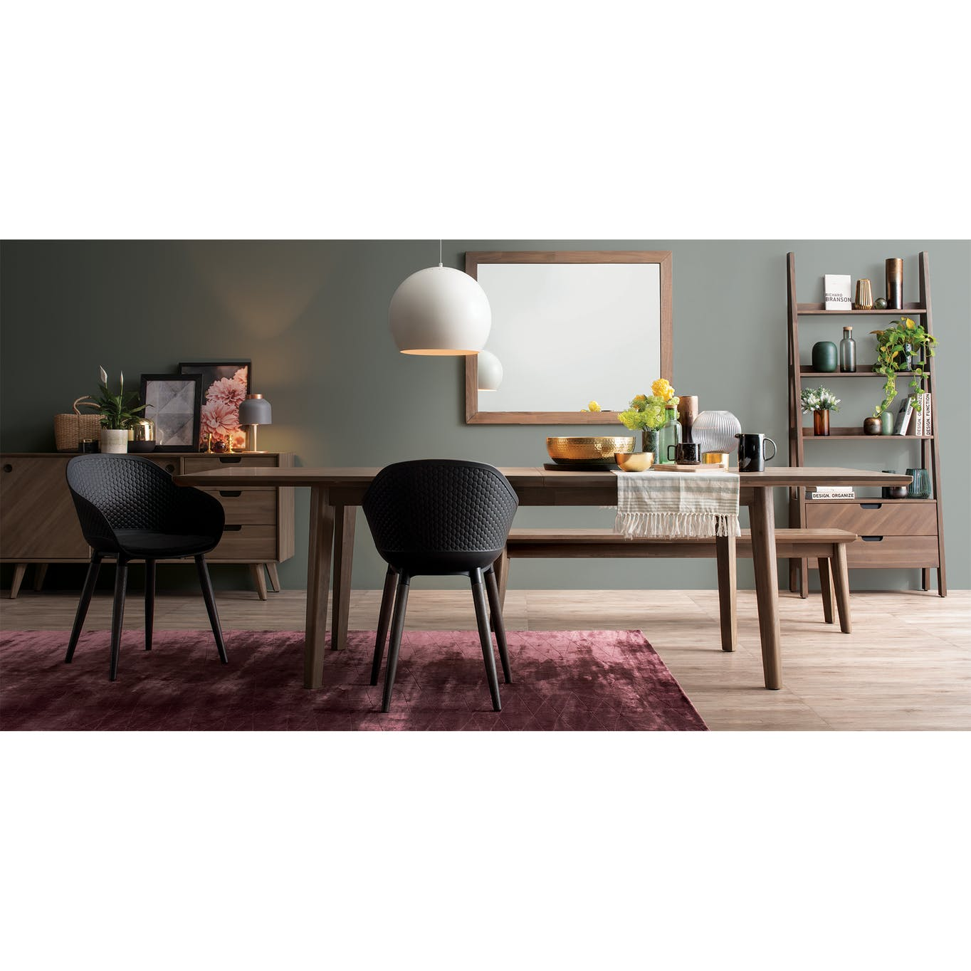 Extendable wooden dining table with tablecloth on it